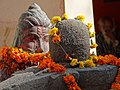 Sculpted Figure and Lingam with Garlands - Outside Patalpuri Temple - Sangam Site - Allahabad - Uttar Pradesh - India (12589414355).jpg
