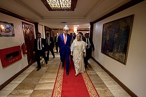Prime Minister's Office (Bangladesh) - U.S. Secretary of State John Kerry walks through the Cross Hall with Bangladeshi Prime Minister Sheikh Hasina Wazed at the Prime Minister's Office in Dhaka.