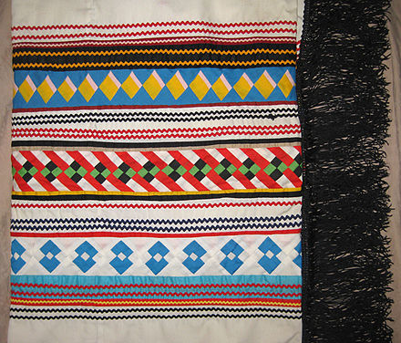 Seminole patchwork shawl made by Susie Cypress from Big Cypress Indian Reservation, c. 1980s Seminole patchwork shawl.jpg