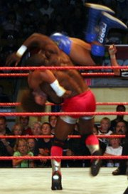 Shelton Benjamin hits the T-Bone Suplex, a variation of the Exploder suplex, on Carlito.