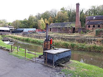 Shropshire Canal - The canal at Blists Hill passes in front of the derelict Madeley Wood Brick and Tile Works