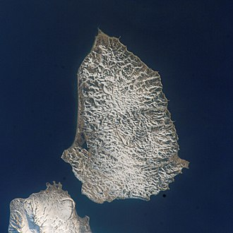 Battle of Shumshu - A Landsat 7 image of Shumshu. The northern tip of Paramushir (formerly Paramushiro) is at left. The First Kuril Strait lies across the upper portion of the image.