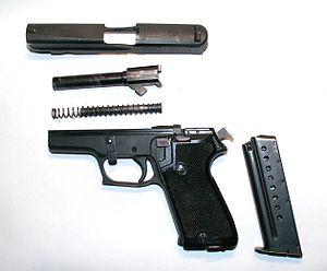 Browning BDA Handguns - field stripped Sig Sauer handgun, takedown lever turned down