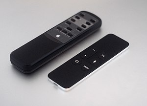 Siri Remote and old Apple Remote.JPG