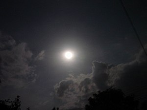 English: Night sky with moon and clouds, in Th...