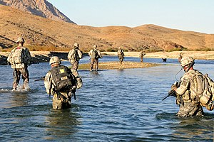 U.S Army Soldiers cross the Arghandab River to...