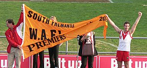 "West Australian Football League - South Fremantle Football Club celebrate with ""The Flag"" and ""The Cup"" after winning the 2005 WAFL Premiership."