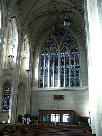 """St. Paul's Cathedral, Dunedin - Interior view looking at the Memorial Window above the front entrance which reads """"This Window was Erected To the Glory of God and in thankful and loving remembrance of those of Otago and Southland who gave their lives in The Great War 1914–1918"""""""