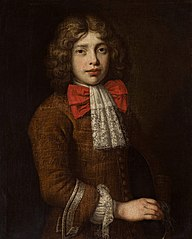 Portrait of a boy with a red bow and ruffle.