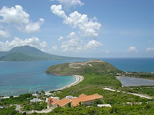 Saint Kitts and Nevis - A view of Nevis island from the southeastern peninsula of Saint Kitts