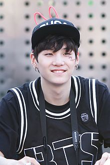 Suga at a fanmeet in Cheongnyangni on July 6, 2013.jpg