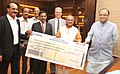 Sunil Duggal presenting a dividend cheque of Rs.2,995 crore to the Union Minister for Finance, Corporate Affairs and Information & Broadcasting, Shri Arun Jaitley and the Union Minister for Mines and Steel.jpg