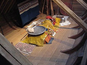 Burial in Anglo-Saxon England - A reconstruction of the princely burial chamber at the late sixth-early seventh century ship burial of Sutton Hoo.