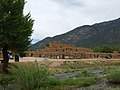 Taos Pueblo by stream of water.jpg