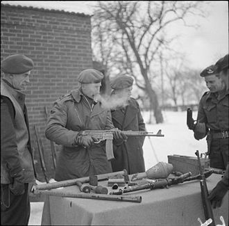 Evelyn Barker - Lieutenant General E. H. Barker, GOC VIII Corps, inspecting various captured German weapons during an inspection of the 3rd Division positions, 26 January 1945.