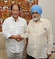 The Chief Minister of Nagaland, Shri Neiphiu Rio meeting the Deputy Chairman, Planning Commission, Shri Montek Singh Ahluwalia for finalizing plan size for 2013-14 for the State, in New Delhi on May 27, 2013.jpg