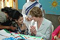 The First lady of USA, Ms. Laura Bush interacting with a child on her visit to Mother Teresa Light of Life Home (Jeevan Jyothi) for disabled children, in New Delhi on March 2, 2006.jpg