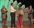 The Minister of State for Information and Broadcasting, Shri Choudhury Mohan Jatua felicitated Actress Padmapriya, during the closing ceremony of the 41st IFFI-2010, at Panaji, Goa on December 02, 2010.jpg
