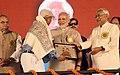 The Prime Minister, Shri Narendra Modi distributing the awards to Champion Swachhagrahis, at the National Convention of Swachhagrahis, at Motihari, in Bihar (2).jpg