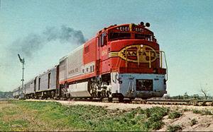 GE U30CG - U30CG 404 pulling the Tulsan in 1969.
