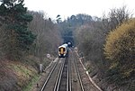 Photograph showing the south portal of Somerhill Tunnel, with a London-bound train about to enter.
