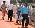 The polling officials carrying polling materials for use in the second phase of General Elections-2009 at one of the EVM distribution centre, at Lal Parade Ground, Bhopal on April 22, 2009.jpg