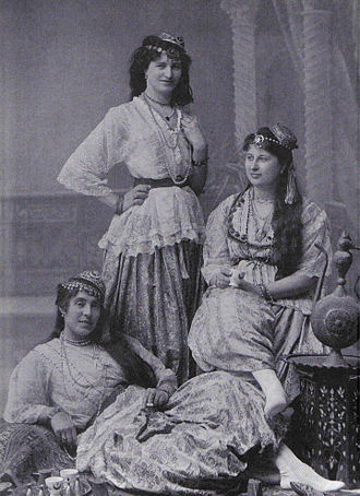 Women in Arab societies - Three women from Algiers in the 1880s; the reclining girl holds a cigarette.