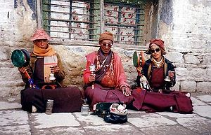 Tibetan people - Three monks chanting in Lhasa, 1993.