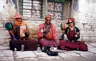 Tibetan people - Three monks chanting in Lhasa, 1993