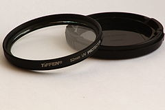 Tiffen 52mm UV filter with lens cap.JPG