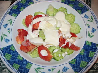 Soviet cuisine - Typical vegetable salad made of tomatoes, cucumbers, onions, and dressed with smetana