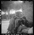 Toni Frissell with several children around her, somewhere in Europe - 19005u.tiff