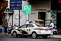 Toyota Corolla Eleventh-Generation China Style Police Car Rear.jpg