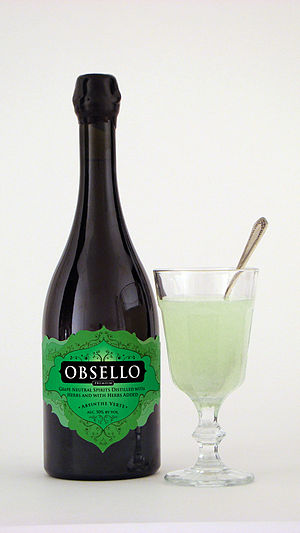 Obsello Absenta - A bottle of Obsello, bottled at 50% ABV. At right is a louched glass.