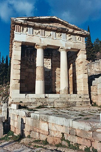 The reconstructed Treasury of Athens, built to commemorate their victory at the Battle of Marathon. Treasury of Athens at Delphi.jpg