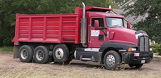 Axle - Dump truck with an airlift pusher axle, shown in the raised position
