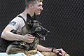 U.S. Air Force Senior Airman Shawn Witcher, assigned to the 673rd Security Forces Squadron, sits with Ajax, a German shepherd and military working dog, after a training session at Joint Base 130826-F-LX370-518.jpg