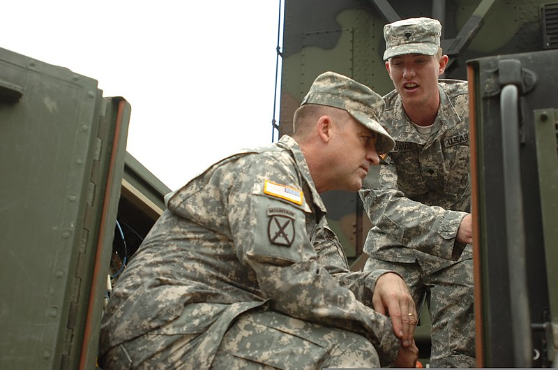 File:U.S. Army Spc. Sean Davis, right, explains recent ...