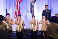 U.S. Coast Guard Lt. Cmdr. Susan Shanahan, stage right, sings the national anthem during the opening ceremonies of the 2013 Joint Women's Leadership Symposium at the Gaylord National Resort and Convention Center 130606-D-HU462-040.jpg
