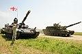 U.S. M1A2 Abrams tank, right, rumbles past a Georgian tank T-72 SIM-1, left, at Vaziani Air Strip, Georgia.jpg