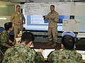 U.S. Marine Corps Capt. Philipp Buckhahn, standing right, an assistant air officer with the 11th Marine Expeditionary Unit, helps instruct Japanese service members about amphibious operations during a planning 130606-M-JU912-009.jpg