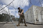 U.S. Marine Corps Lance Cpl. Alex Hogue, with Marine Aircraft Group 12, 1st Marine Aircraft Wing, sets up barbed wire at the unit's operations center during exercise Forager Fury at Andersen Air Force Base 131127-M-UH847-023.jpg