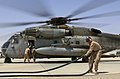 U.S. Marine Corps Lance Cpl. Gage Cusker, a nozzle operator with Marine Wing Support Squadron (MWSS) 274, straightens a hose after refueling a CH-53E Super Stallion helicopter at a forward arming and refueling 140903-M-EN264-228.jpg