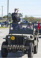U.S. Marine Lt. Gen. Richard P. Mills, commander of Marine Forces Reserve and Marine Forces North, salutes the Young Marine program and service veterans as the parade comes to an end at the Southeast La 131111-M-IJ438-140.jpg
