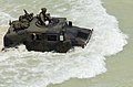 U.S. Marines drive through the waves toward the beach in a High-Mobility Multipurpose Wheeled Vehicle during amphibious assault training in support of exercise Rim of the Pacific '04.jpg