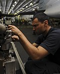 U.S. Navy Aviation Electrician's Mate 2nd Class Jordan Gutierrez performs engine maintenance June 9, 2013, aboard the aircraft carrier USS Nimitz (CVN 68) while underway in the Indian Ocean 130609-N-TX484-105.jpg