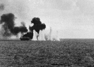 Casablanca-class escort carrier - USS Gambier Bay under fire at Samar, 1944
