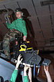 US Navy 030329-N-4560C-504 Aviation Structural Mechanic 2nd Class Kathryn Robins from Los Angeles, Calif., performs maintenance on an ejection seat for an F-A-18C Hornet assigned to the.jpg