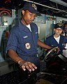US Navy 050503-N-9563N-008 Seaman Melvin Yancy, left, from Alexandria, La. and Seaman Katrina Knapp, from Pintkney, Mich., stands watch on the bridge of the guided missile destroyer USS Mustin (DDG 89).jpg