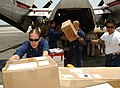 US Navy 050516-N-3494S-059 Sailors assigned to the Carl Vinson Carrier Strike load a C-2 Greyhound plane before its return flight to deliver mail to the ship.jpg